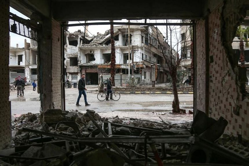 Damaged and destroyed buildings are seen in the Syrian rebel-held enclave of Arbin in Eastern Ghouta on Feb 17, 2018.