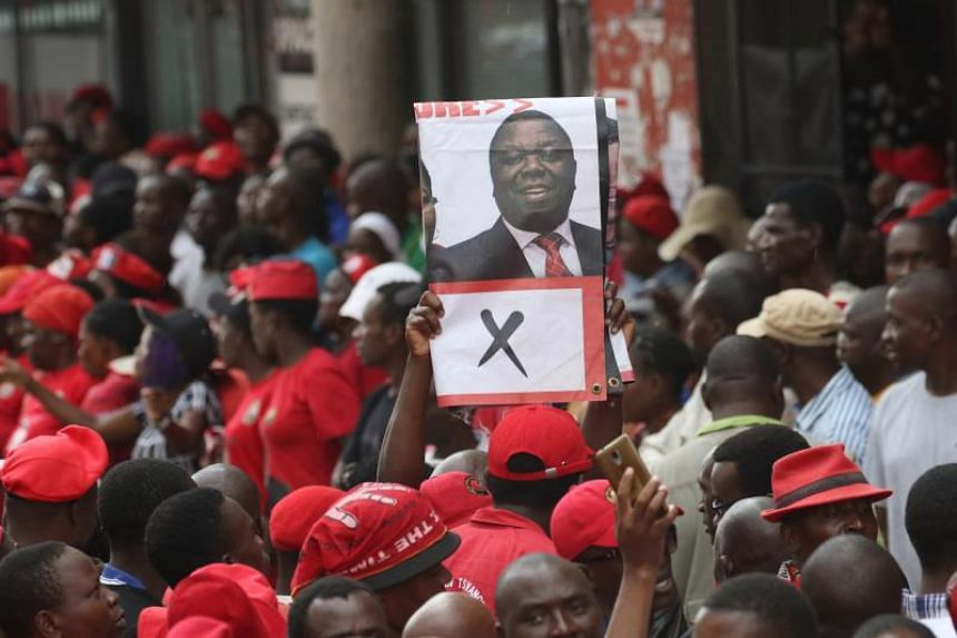 Thousands of the Movement For Democratic Change supporters mourning the death of party leader Morgan Tsvangirai, outside the party's headquarters in Harare on Feb 18, 2018.