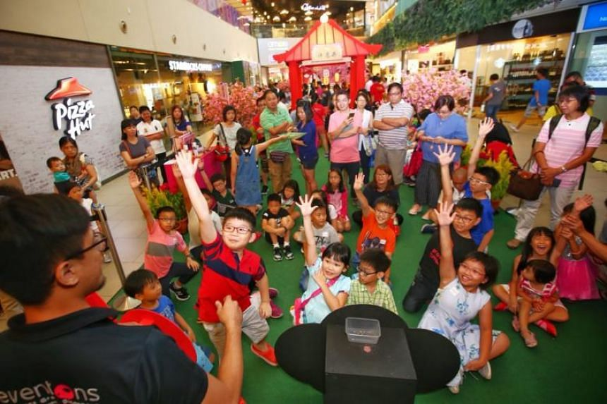 Children at the Straits Times Pocket Money Fund (STSPMF) event held at Seletar Mall on Feb 19, 2018. The STSPMF provides pocket money to children from low-income families to help with school-related expenses, such as buying meals or paying for transp
