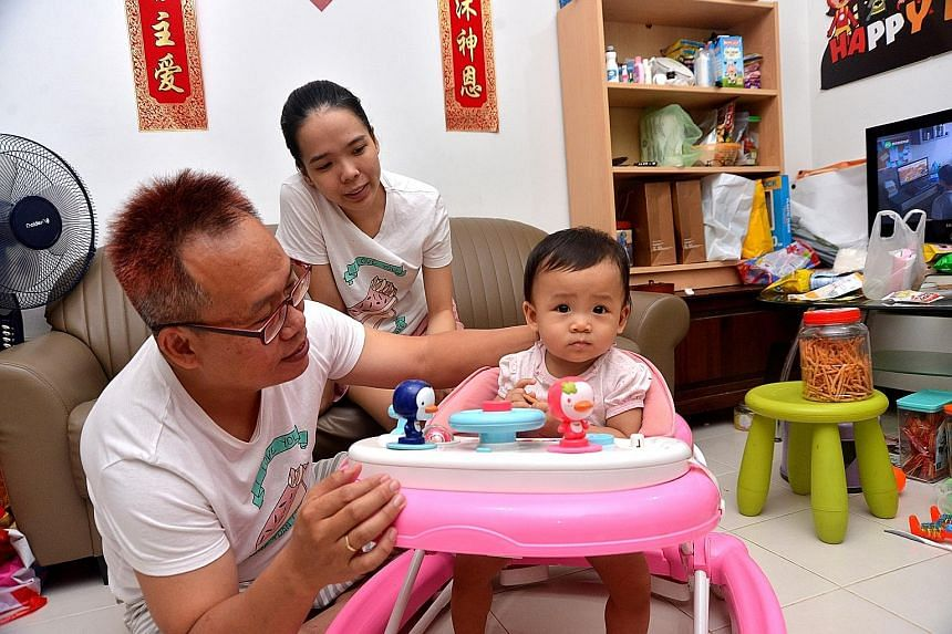 Mr Tony Teng, with wife Nguyen Thi Huyen Linh, 26, and one-year-old daughter Donna, is worried about his young family's growing expenses. Academics and experts noted that the lower-income groups will feel the pinch more from a GST increase.