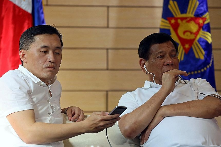 Philippine President Rodrigo Duterte with his special assistant Christopher Go in a photo taken last year. Mr Go has denied any wrongdoing in the procurement process for two frigates for the country's navy.
