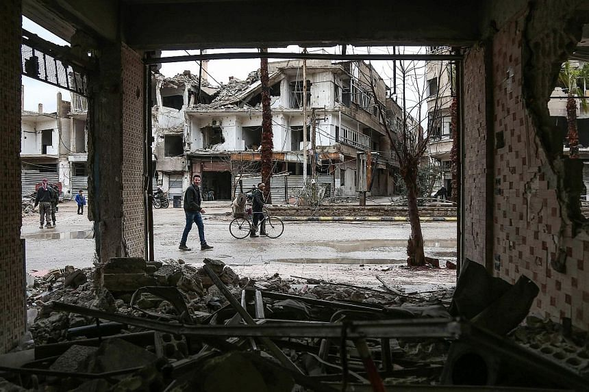 Destroyed buildings in Eastern Ghouta near Damascus last Saturday. Failing to reach a deal to evacuate a militant faction could signal the start of a ground assault.