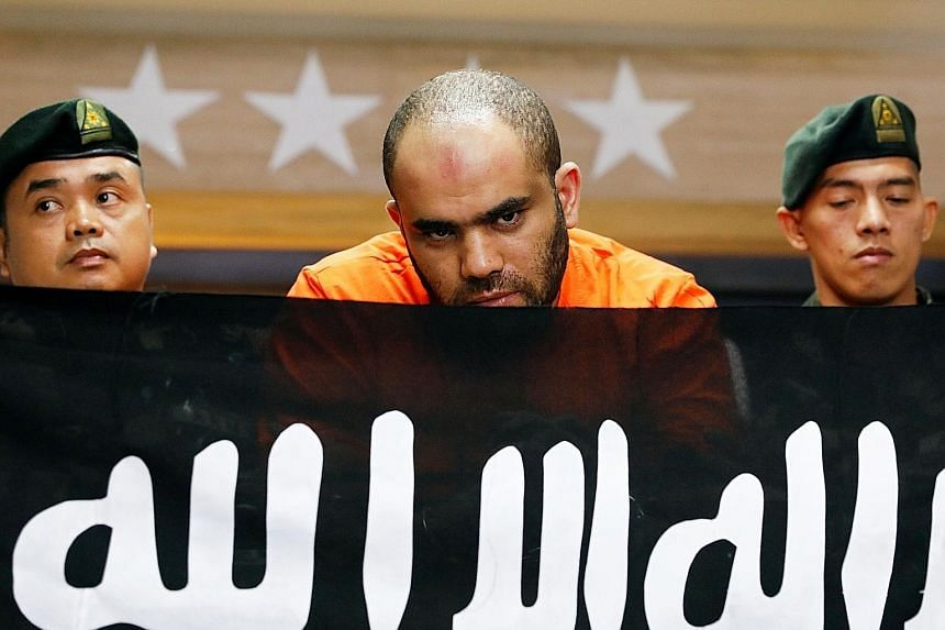 "Foreign national Fehmi Lassoued at a press briefing called by Philippine police yesterday. He is alleged to have been a ""commander"" and ""government negotiator"" of ISIS in Syria."