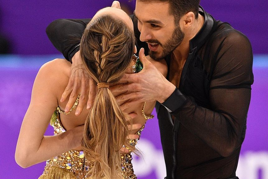 Gabriella Papadakis and Guillaume Cizeron managed to complete the ice dance short programme despite her top coming off. But while she was in tears, their second-placed score gave them cheer.