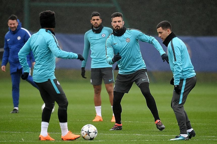 Chelsea striker Olivier Giroud (second from right) in training with team-mates including Emerson Palmieri (back) and Eden Hazard (right) ahead of today's Champions League last-16, first leg at Stamford Bridge. Blues manager Antonio Conte has a select