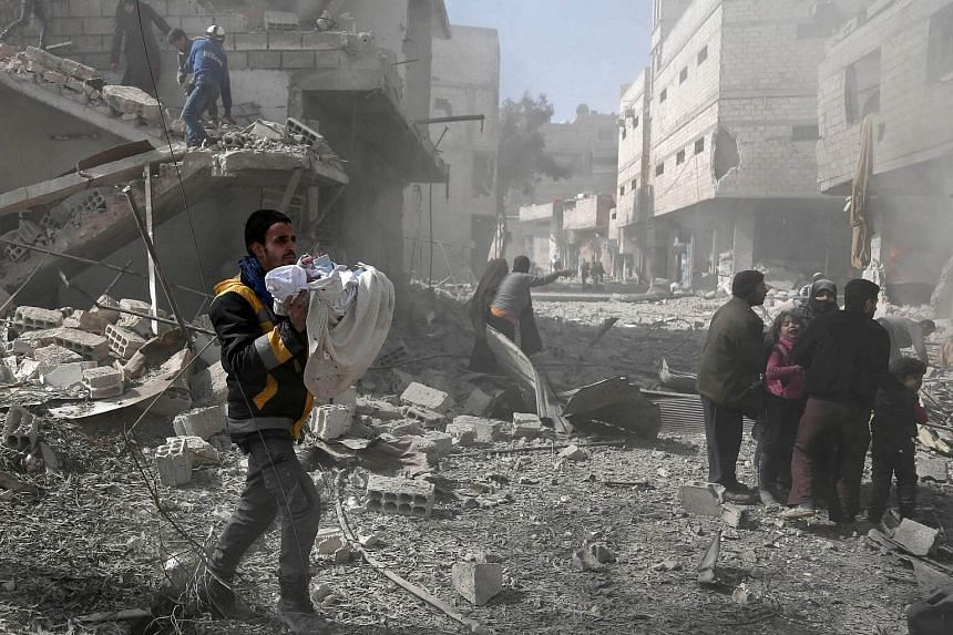 Air strikes killed 20 people and wounded dozens in the town of Hammouriyeh alone on Feb 19, 2018.