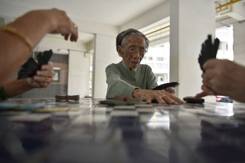 Madam Cheng Wah Joeng, 102, still makes new friends – neighbours in their 70s and 80s. They spend the afternoon sometimes playing cards in the void deck.
