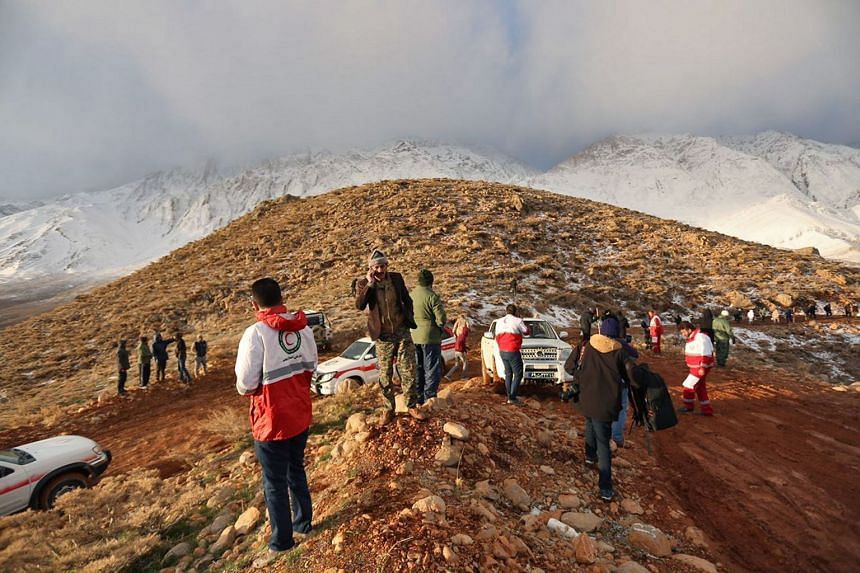 Rescuers searching for the wreckage of Aseman Airlines flight EP3704 in Iran's Zagros mountain range, on Feb 19, 2018.