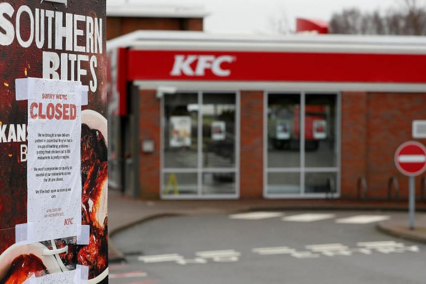 A closed sign hangs on the drive through of a KFC restaurant after problems with a new distribution system in Coalville, Britain, Feb 19, 2018.