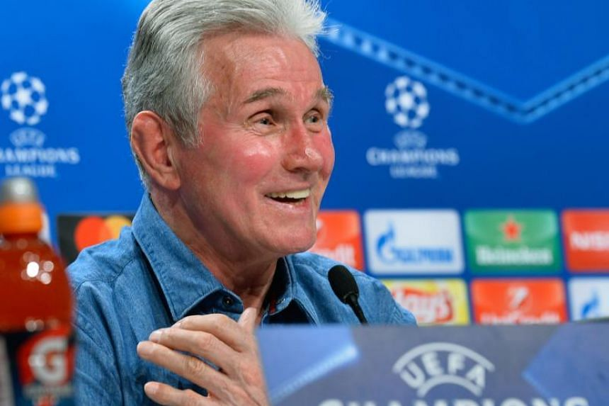 Bayern Munich's head coach Jupp Heynckes smiles during a press conference on Feb 19, 2018 in Munich, southern Germany, on the eve of the UEFA Champions League round of sixteen first leg football match Bayern Munich vs Besiktas Istanbul.