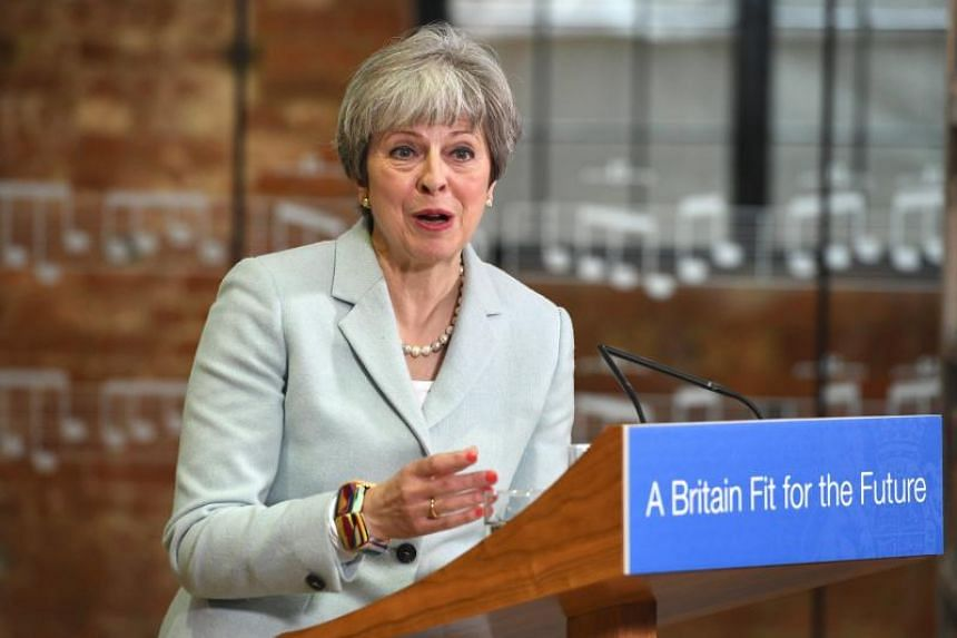British Prime Minister Theresa May delivers a speech to students and staff during her visit to Derby College in Derby, East Midlands, Britain, on Feb 19, 2018.