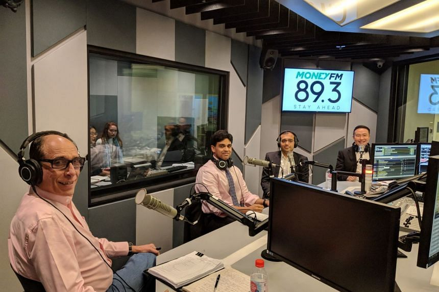 (From left) Mr Vikram Khanna, associate editor of The Straits Times; Mr Vishnu Varathan, head of economics and strategy at Mizuho Bank; Mr Ajay Sanganeria, tax partner at KPMG; and Mr Toby Koh, managing director at Ademco Security.