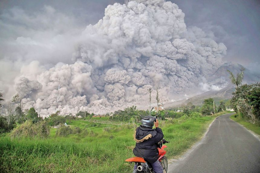 Mount Sinabung spewing thick volcanic ash into the air in Karo, North Sumatra, yesterday. The Indonesian volcano, which has been rumbling since 2010 and saw a deadly eruption in 2016, emitted the thick plume after activity picked up in recent days. T