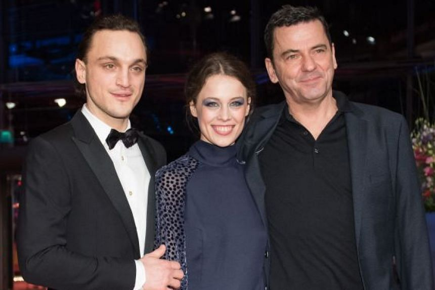 German director Christian Petzold (right) on the Berlin Film Festival red carpet with German actor Franz Rogowski (left) and German actress Paula Beer, who star in his film, Transit.