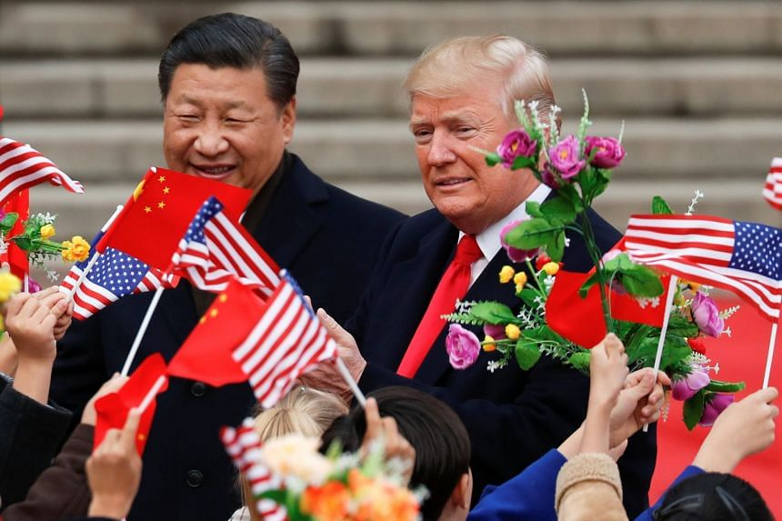 US President Donald Trump and Chinese President Xi Jinping attending a welcoming ceremony at the Great Hall of the People in Beijing on Nov 9, 2017.