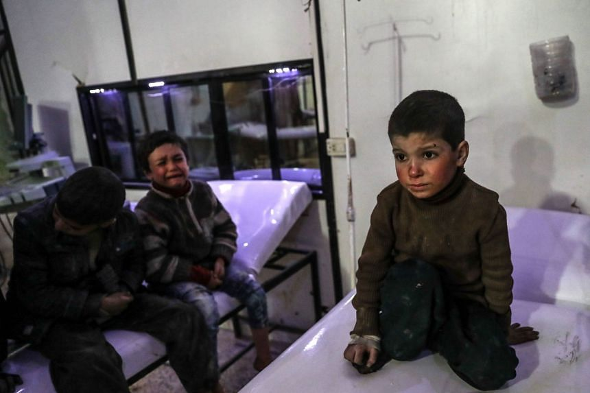 Injured children receiving medical treatment inside a hospital in rebel-held Douma, Eastern Ghouta, Syria, on Feb 19, 2018.