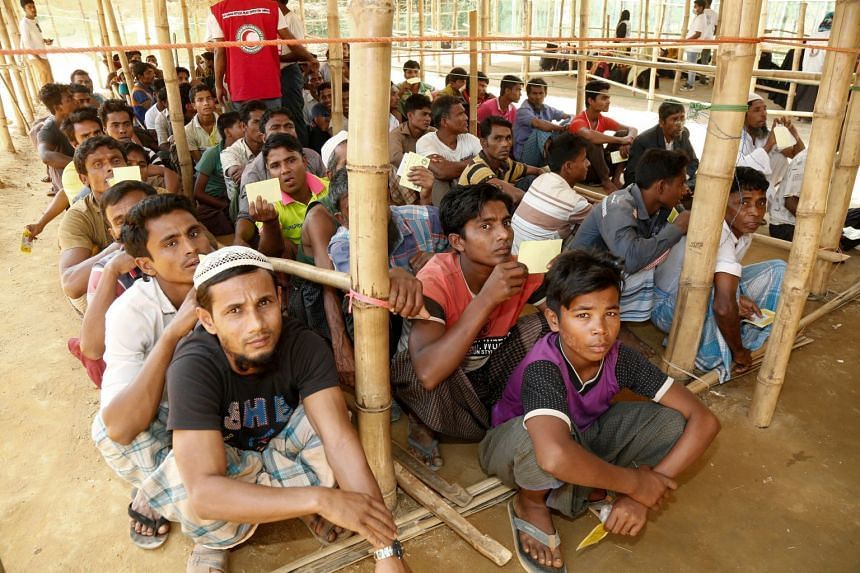 Newly arrived Rohingya refugees waiting for relief goods inside the UNHCR distribution point at the newly extended camps Kutupalong in UKhiya, Cox's Bazar, Bangladesh, on Feb 12, 2018.