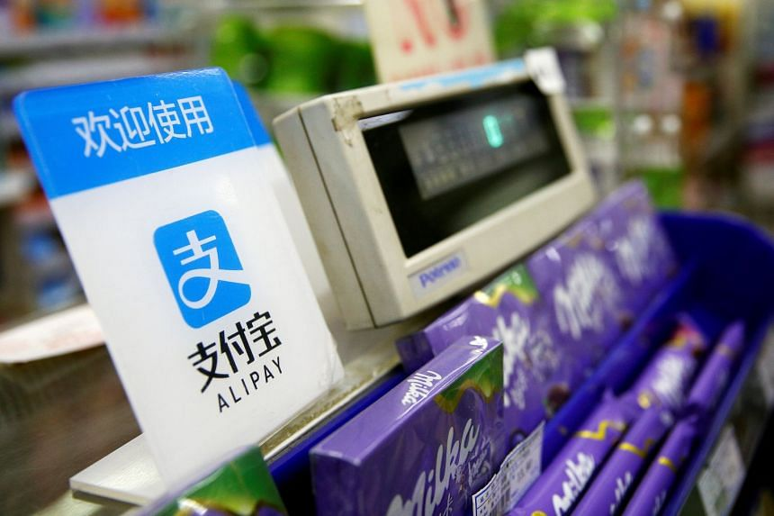 An Alipay logo is seen at a cashier in Shanghai. A report by Deloitte said that about 500 of about 1,000 smart city pilots were in cities in China.