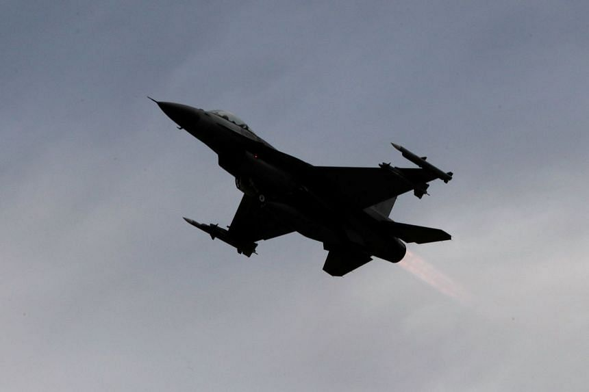 Japan has demanded an explanation from the US after a USAF F-16 (example aircraft pictured) dropped two fuel tanks into Lake Ogawara in Aomori prefecture after an accident.