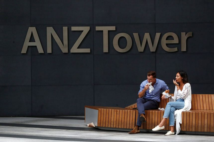 People eating lunch outside the ANZ Banking Corporation tower in Sydney, on Feb 20, 2018.