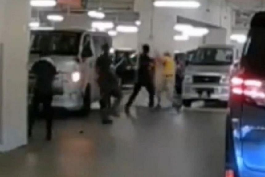 In a video of the incident, the men can be seen fighting each other, before passers-by broke them up.