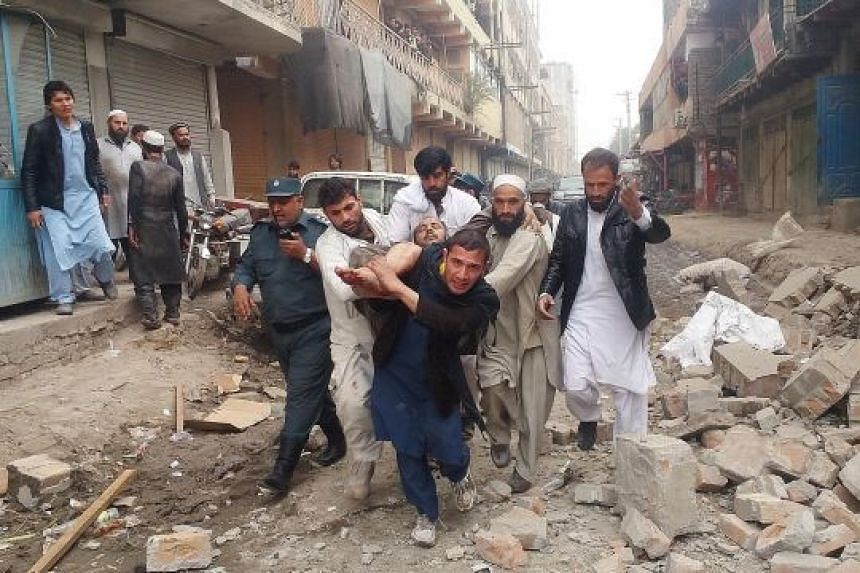 An injured man being carried away after the blast in Jalalabad yesterday. The explosion, which killed at least three tribal elders and wounded two, went off on the second floor of a hotel where the tribal elders were staying. The cause of the blast w