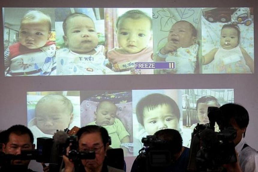 Photos of the surrogate babies were shown by the Thai police at a news conference in 2014. The scandal at the time shone an international spotlight on Thailand's largely unregulated surrogacy business, prompting the authorities to crack down on such