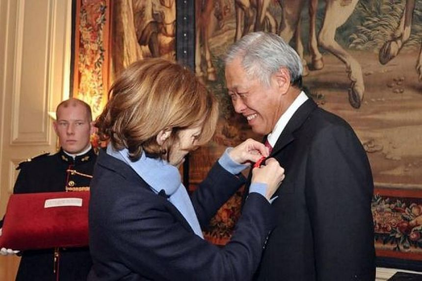 French Defence Minister Florence Parly presenting the Legion of Honour award to Dr Ng in Paris on Monday.