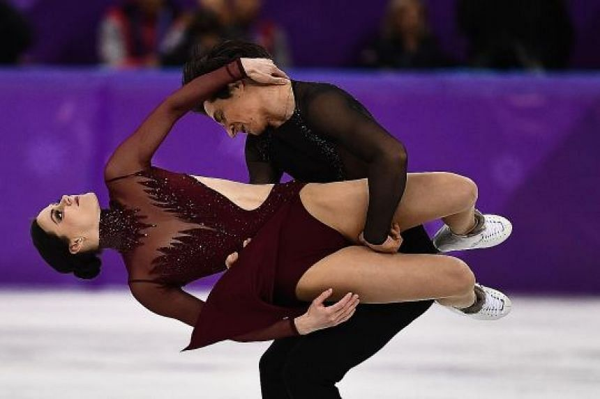 Canada's Tessa Virtue and Scott Moir on their way to becoming the Olympic ice dance champions for a second time, with a world record score of 206.07 in Pyeongchang yesterday. The pair, who also won gold in the team event last week, retired after the