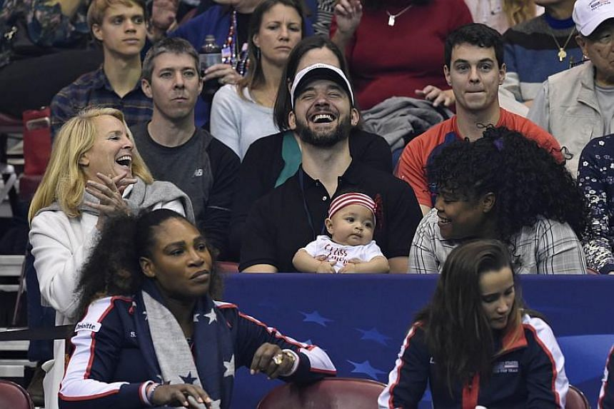 Serena Williams (bottom left) along with her husband Alexis Ohanian and their daughter Alexis Olympia (centre) watch the action during the first round of the 2018 Fed Cup at US Cellular Center on Feb 10, 2018.
