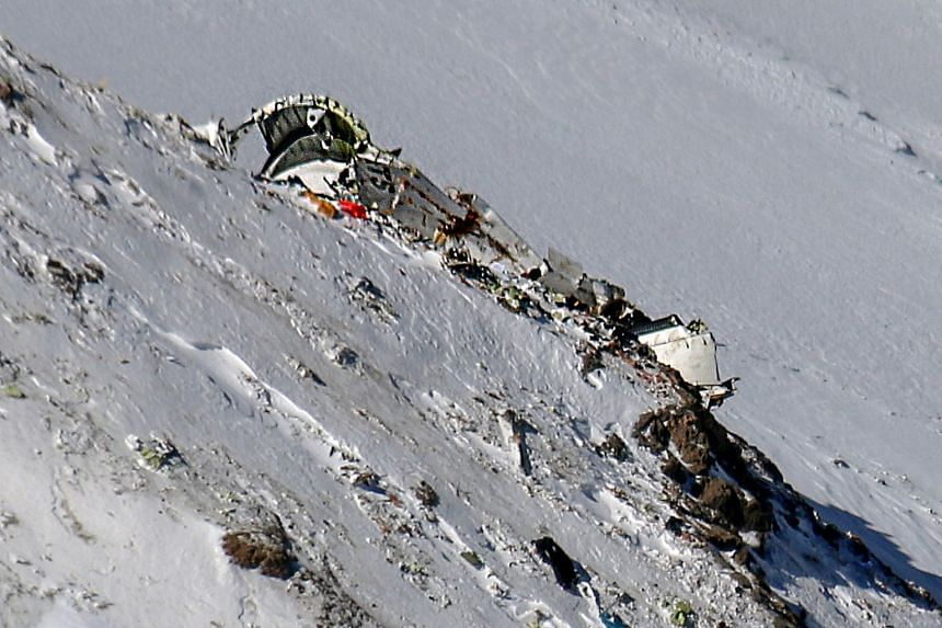 A picture shows on Feb 20, 2018 the wreckage of the plane.