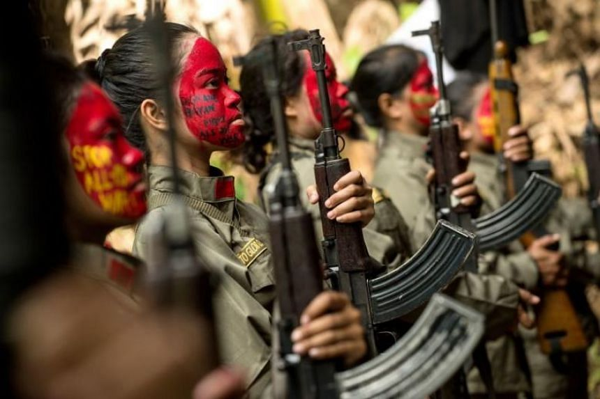 Guerrillas from the New People's Army (NPA) in formation in the Sierra Madre mountain range, east of Manila, on July 30, 2017.
