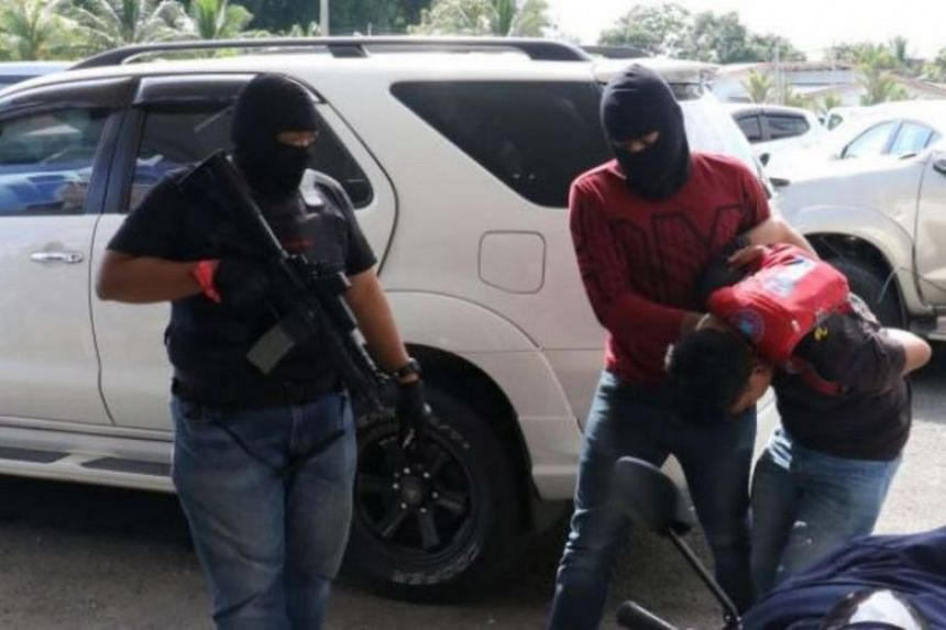 One of the suspected militants detained in Sandakan on Jan 25, 2018.