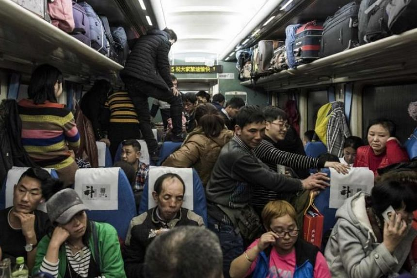 Passengers travelling on board a crowded train from Beijing to Chengdu, on Feb 10, 2018.