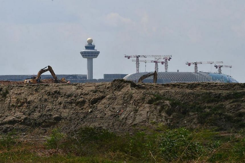 Construction site of Changi Airport's Terminal 5 with Terminals 1 and 2 seen in the background.