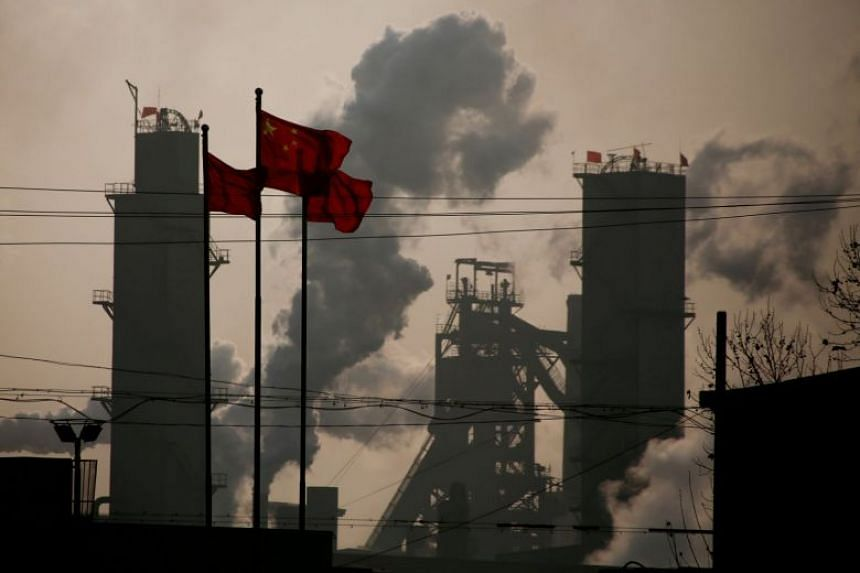Chinese national flags flying near a steel factory in China's Hebei province in a photo taken on Feb 23, 2017.