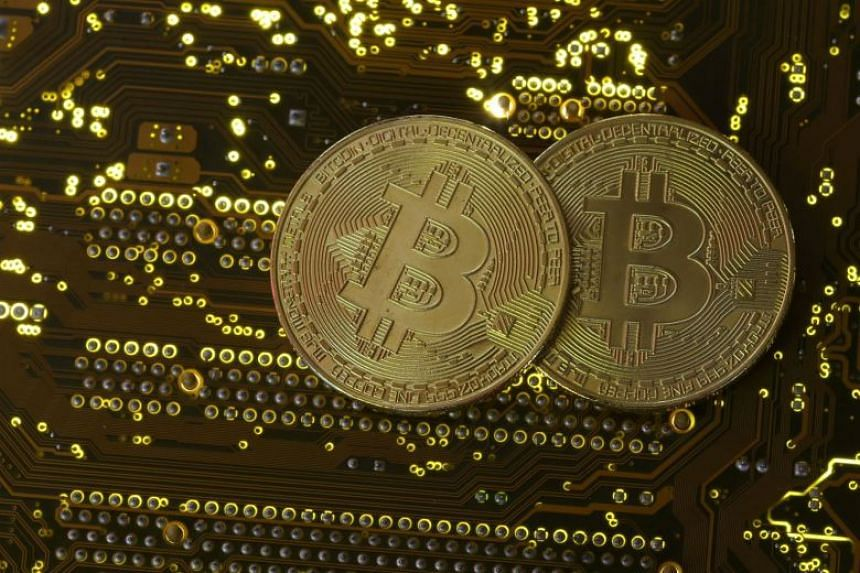 Copies of bitcoins standing on a PC motherboard in an illustration picture taken on Oct 26, 2017.