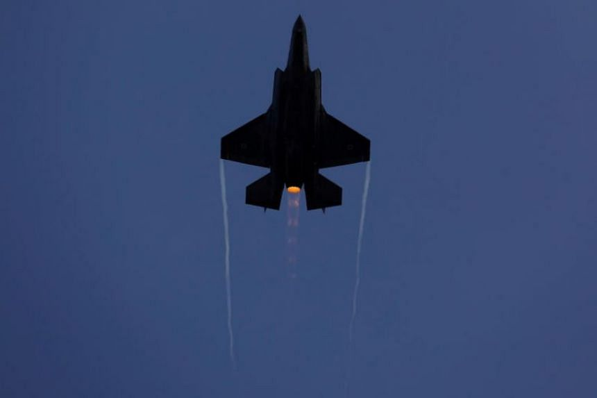 An Israeli Air Force F-35 fighter jet flies during an aerial demonstration at a graduation ceremony for pilots.