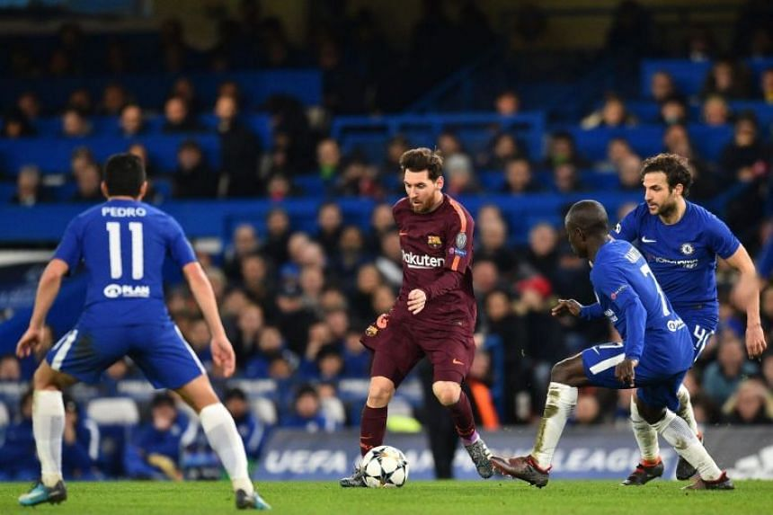 Barcelona's Argentinian striker Lionel Messi (centre) surrounded by Chelsea's Spanish midfielder Pedro (left) Chelsea's French midfielder N'Golo Kante (second, right) and Chelsea's Spanish midfielder Cesc Fabregas (right), on Feb 20, 2018.