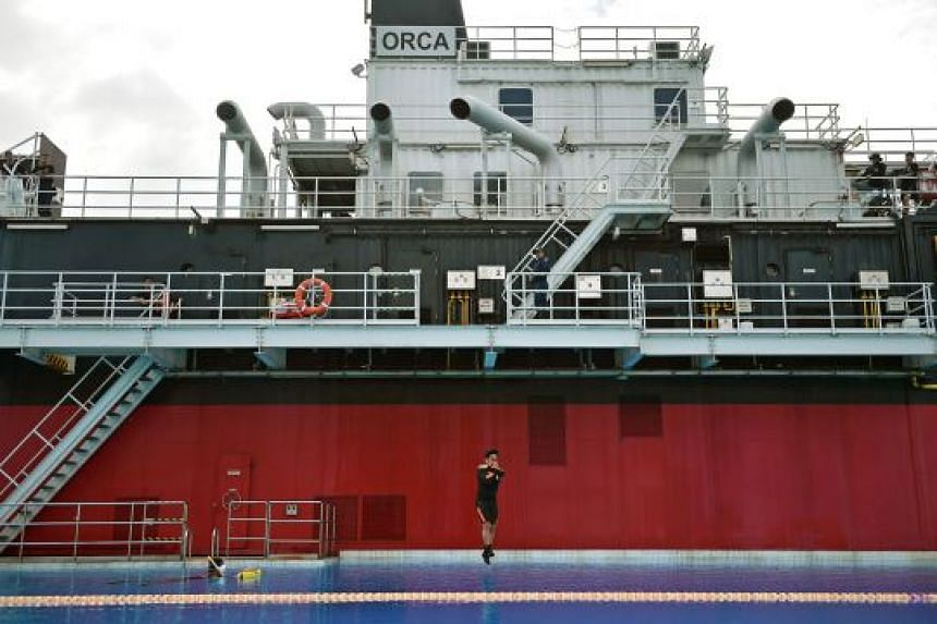 A member of the SCDF Marine Command demonstrates the confidence jump on board the Orca, a ship training simulator at the Home Team Tactical Centre. Marine firefighters must be comfortable jumping from heights in case they have to abandon ship during