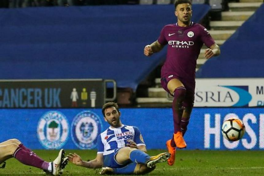 Wigan's Will Grigg scoring the game's only goal after a mistake by Manchester City's Kyle Walker.