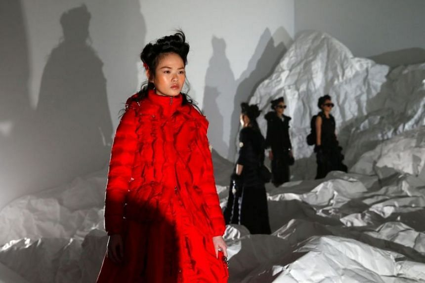 Models present creations from the Moncler Autumn/Winter 2018 women collection during Milan Fashion Week in Milan, Italy on Feb 20, 2018.