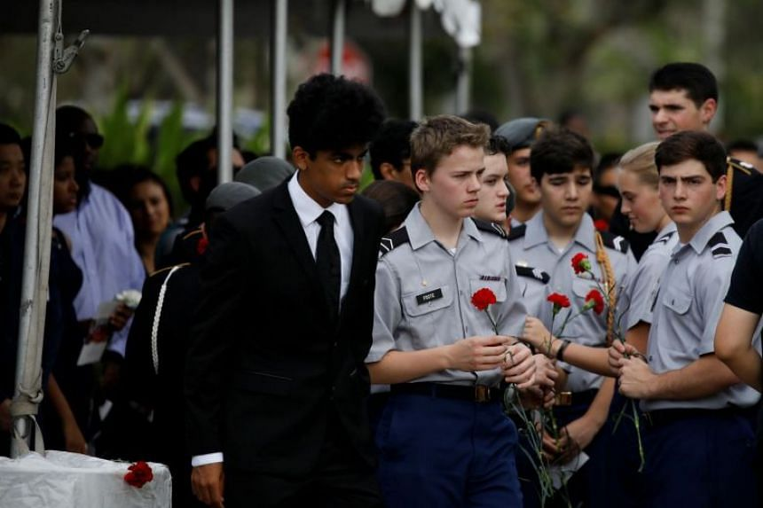 Mourners attend the funeral service for Marjory Stoneman Douglas High School student Peter Wang in Coral Springs, Florida, on Feb 20, 2018.