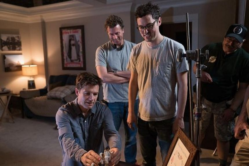 (From left) Actor Jason Bateman on the set of Game Night, which is directed by Jonathan Goldstein and John Francis Daley. With them is a crew member.