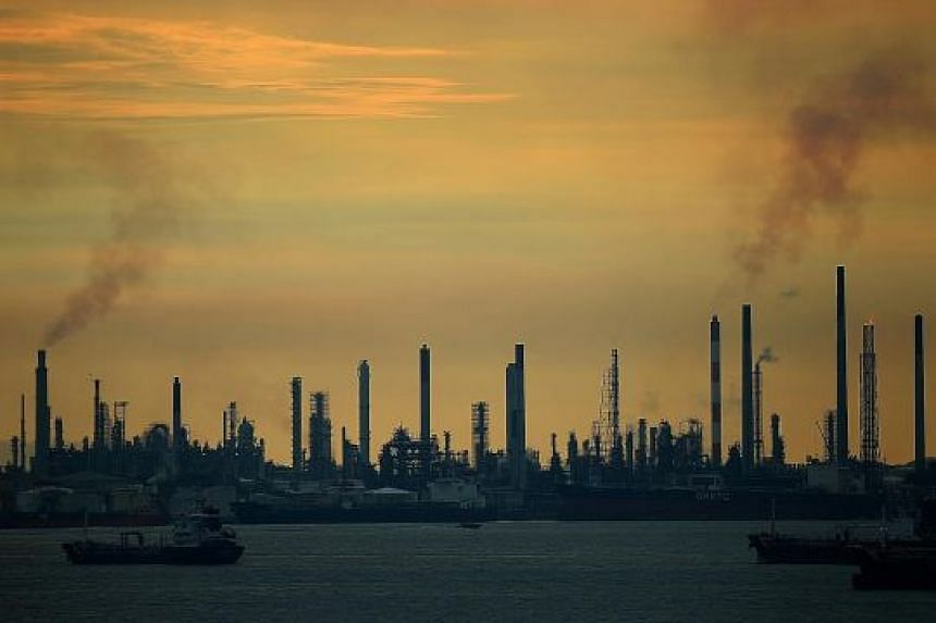 An oil refinery on Pulau Bukom. A carbon tax puts a price on pollution. In Singapore, the 30 to 40 large emitters - mainly from the petroleum refining, chemical and semiconductor sectors - will pay up to $15 per tonne of emissions by 2030.