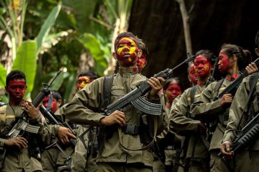Guerillas of the New People's Army - the communist party's armed wing - in formation in the Sierra Madre mountain range, east of Manila, last year.