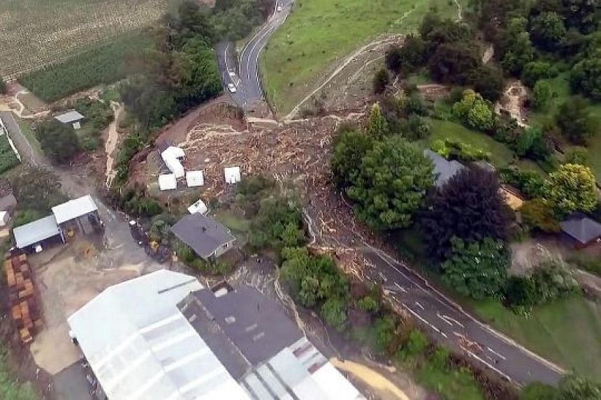 Takaka Hill on the South Island of New Zealand, after the onslaught of the storm Gita. The still image, taken from drone footage on Tuesday, was obtained from social media.