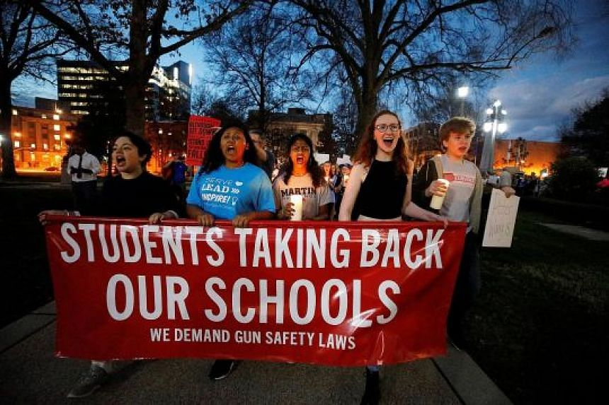 High school students holding a rally to call for safer gun laws, outside the North Carolina State Capitol building on Tuesday. The mass shooting at Marjory Stoneman Douglas High School in Parkland, Florida, has reignited the debate over gun control i
