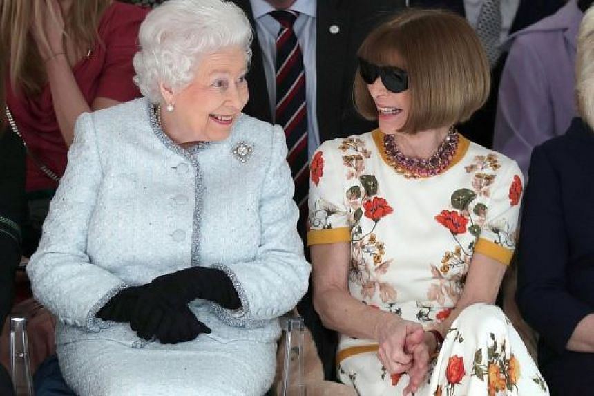 Queen Elizabeth with Vogue's Anna Wintour at the front row of London Fashion Week on Tuesday before presenting designer Richard Quinn with the inaugural Elizabeth II Fashion Award.