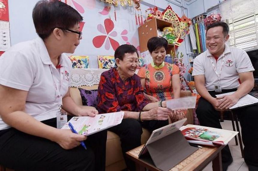 Ms Indranee Rajah chatting with Madam Chua Lye Suan, 77, during a visit to her home in Teck Whye Lane yesterday. With them were Pioneer Generation Ambassadors Audrey Goh, 58, and Alex Goh, 34. SEE EDITORIAL A24